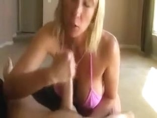 Cougar cums giving a giant schlong tugjob