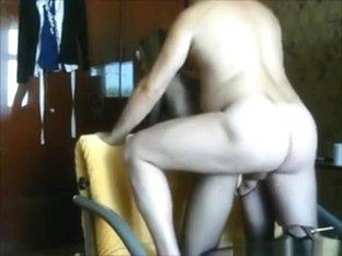 Blonde milf with fishnet fucks on the sofa