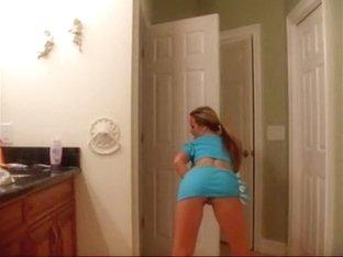 Pretty blondie stripteases in bathroom