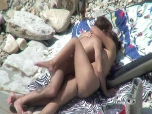 Interesting in nature's garb couple on the beach