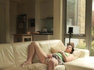 Bored babbysitter masturbates on sofa