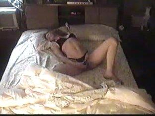 Woman masturbating in BedRoom