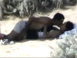 Couple making out on the beach