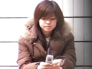 Jazzy teenage Asian chick is the main target of some voyeur sharking chap