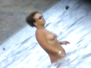 Fat ass big boobed woman is swimming at the summer beach