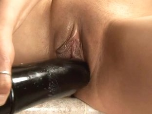Legal Age Teenager masturbating with a large brutal fake penis