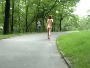 An exhibitionist whore walks in the park.
