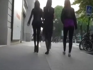 These smokin' hot babes walking down the street have legs for days