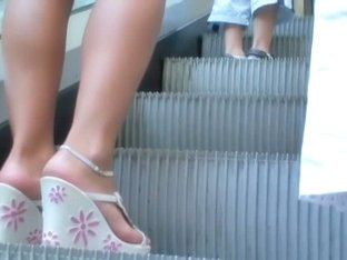 Blonde stunner surrenders an upskirt view on the stairs