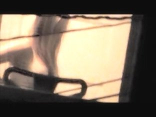 Sexy babe with naked boobs voyeured thru the window