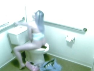 Unaware girl got caught on camera fingering on a toilet