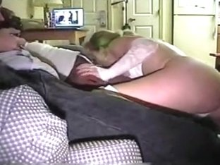 Ponytailed blonde cuckold milf with big boobs blows her black stud's cock, while her husband watch.
