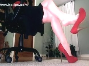 sexy legs and heel dangling