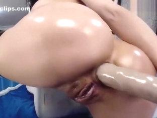 Depraved brunette AngelKiuty fucks her ass with big dildo