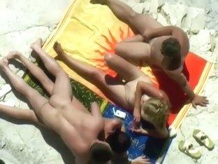 Horny blonde enjoys the beach