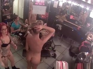 Tattooed chick puts lotion on stripper