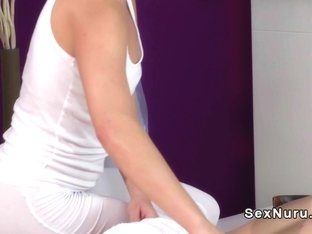 Blonde masseuse gives double handed handjob