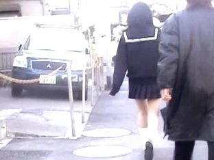 Asian schoolgirl skirt sharked by a nasty pervert.