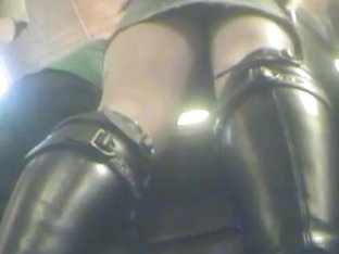 Slut in leather boots and thigh tattoo in public upskirt vid
