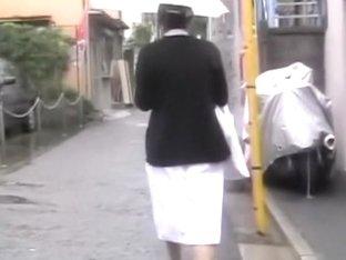 Shy oriental nurse getting pulled into some rainy sharking scene