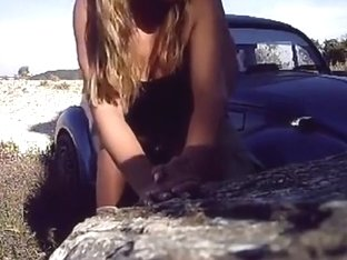 Girl sucks cock and gets doggystyle fucked on a rock in nature