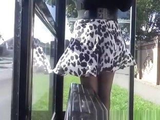 Wind lifts woman's short skirt