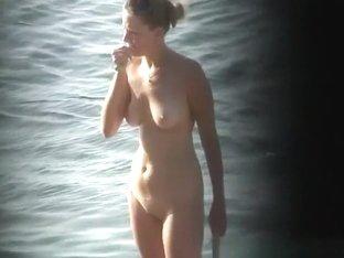 Nudist woman in water