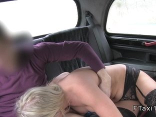 Busty blonde fucks huge dick in cab