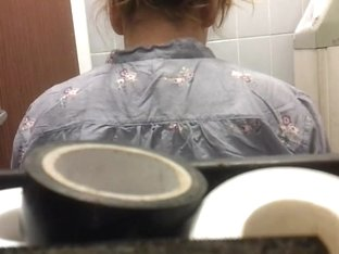Amateur girl shot from the back by a hidden camera in a bathroom