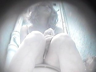 A hidden toilet spy cam video of a hot blonde taking a piss