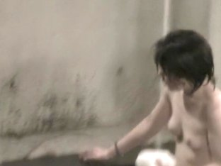 Naked Asian sitting back to the voyeur cam in shower room nri039 00