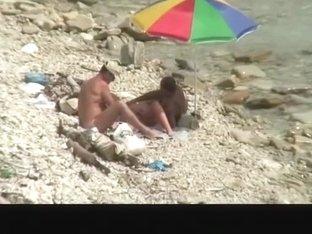Nudist man fucking nude woman in beach