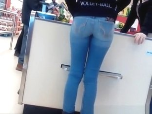 Girl in tight jeans pants at the supermarket