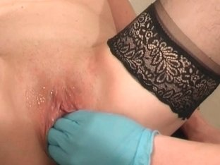 Granny receives fisted and squirts her twat juice