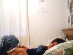 cute amateur couple having fun on bed