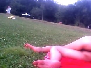 Girl in tiniest bikini getting sun tanned in the field PICT0011