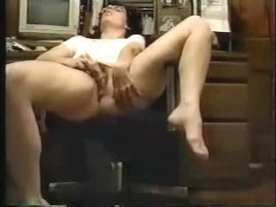 Secretary fingers herself at work