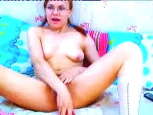 Redhead with glasses fun with dildo