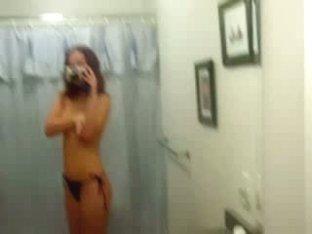 Half naked babe films tit