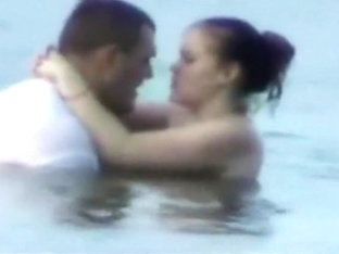 Voyeur tapes a horny couple having sex in the sea