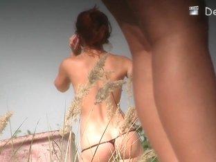 Topless girl talking on the phone on voyeur hunter