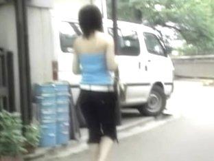 Asian teen gets a boob sharking in broad day light.