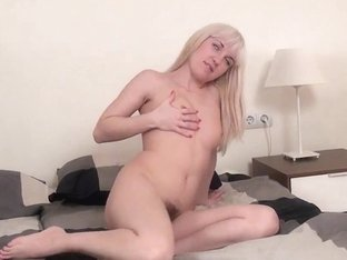 Blonde hairy girl Angie takes a large red dildo