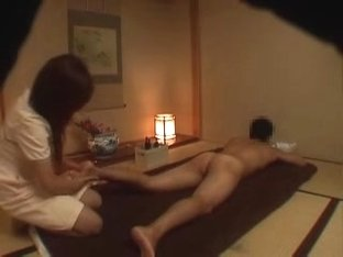 Japanese gal massages a naked dude