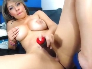 Busty babe HornyEasy2u plays with a rubber dildo