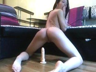 Superb body honey riding her fake penis