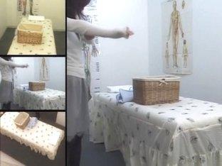 Lovely Asian babe gets fingered in voyeur massage video