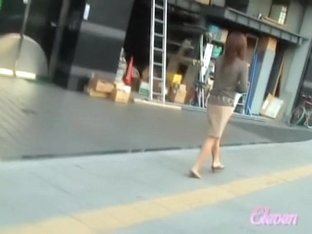 Brown-haired pretty slapper walking down the street during quick sharking