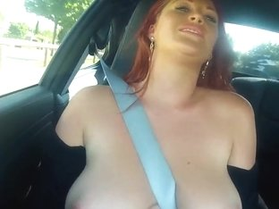 Paige aka Ruby Rubber is posing at the car