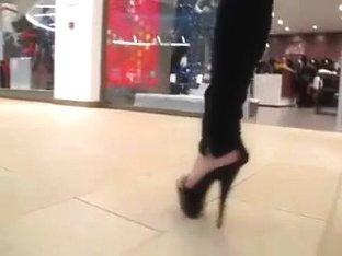 teen heel flashing in mall